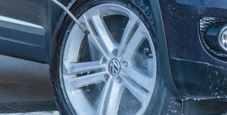 spray washing a car