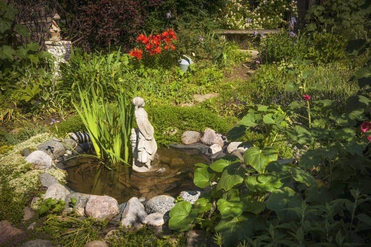 Garden pond with concrete statue