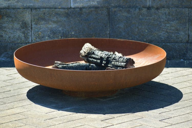 What do you put under a fire pit?