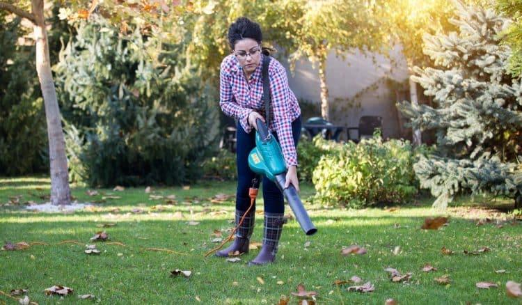 Lady using leaf blower